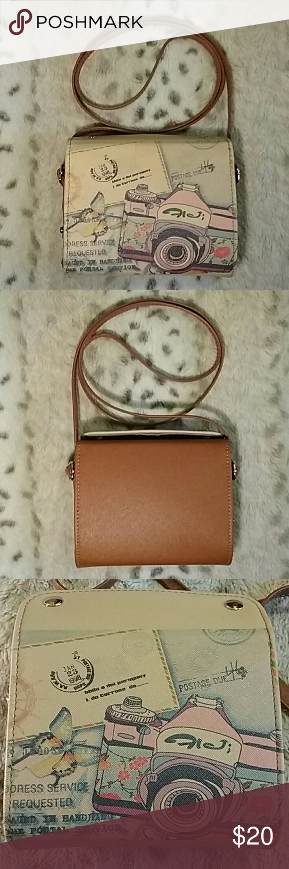 Crossbody Purse Pre-Used condition small crossbody camera purse. Sturdy with snap button closure. Includes one small pocket. In great condition, just has some light chipping/peeling on the top lip of the purse (pictured above). Strap is not adjustable but I'm about 5'7 and it comes down to my hip/lower torso. ☆Make an offer!☆ Bags Crossbody Bags #camerapurse