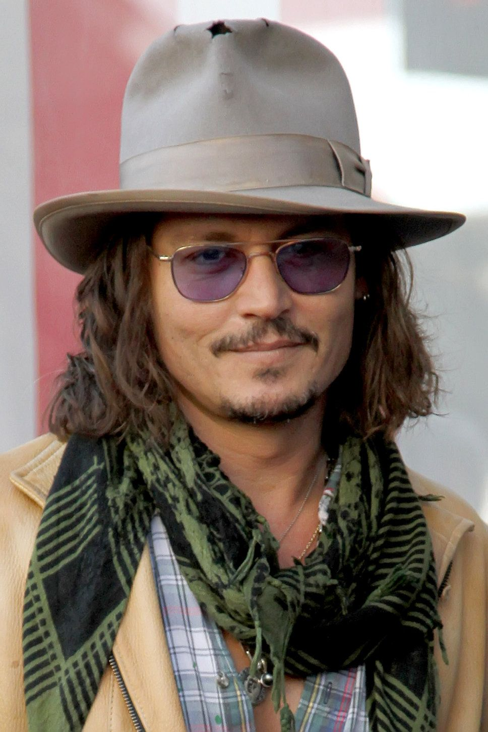 Johnny Depp Beige Jacket Checked Shirt Black And Green Scarf Sunglasses Grey Hat Long HairJohnny Is A Typical Bohemian Type Of Guy