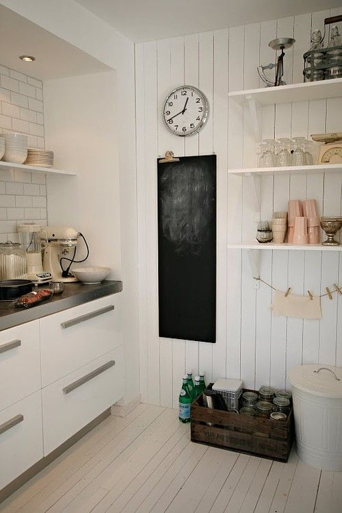 the clock, the crate, the walls, open shelves, the chalkboard. I love it