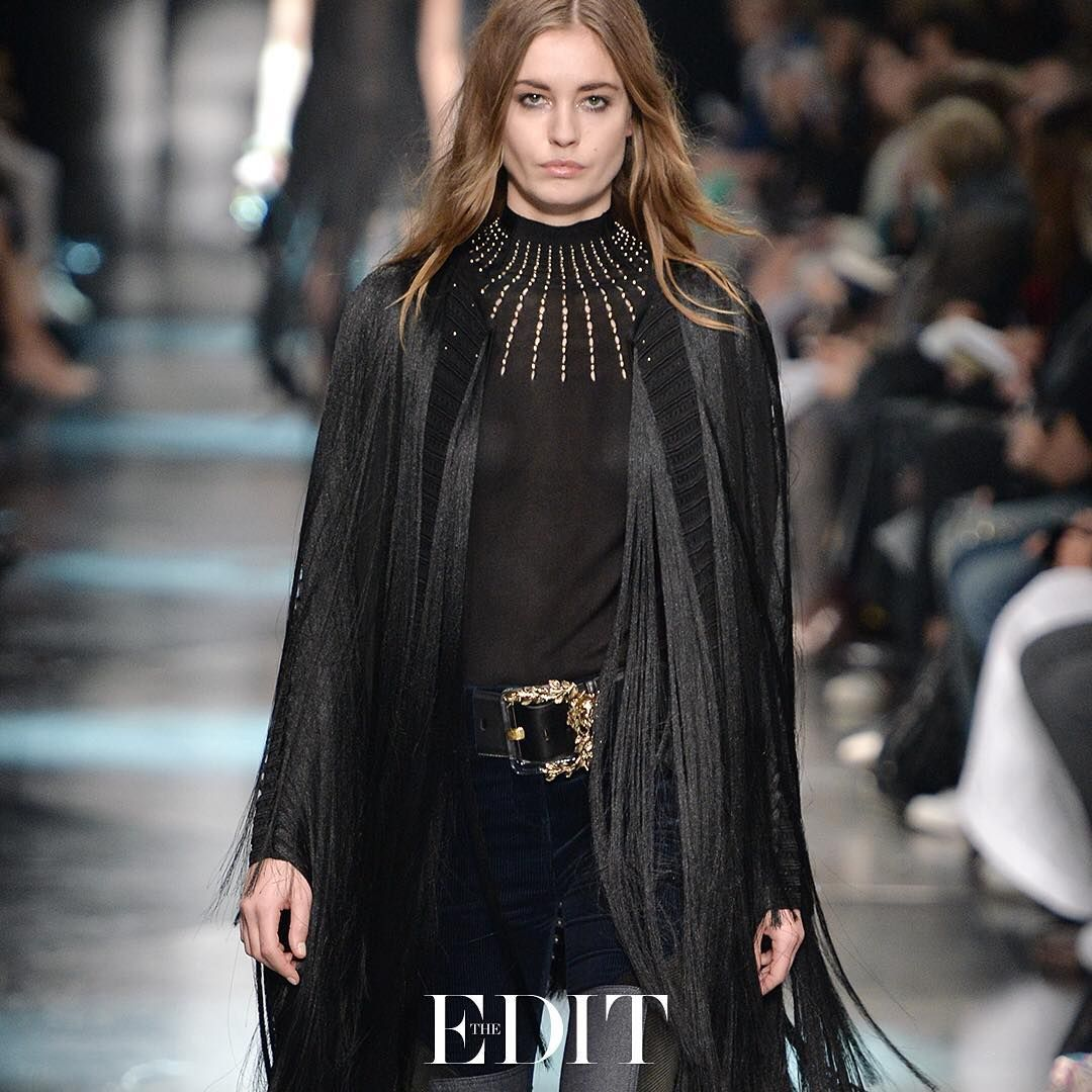 """Flowing, fringing and plenty of gothic drama – #robertocavalli's black #cape is the style to covet this season. #CapeCrusade #THEEDIT #SeeitLoveitBuyit"""