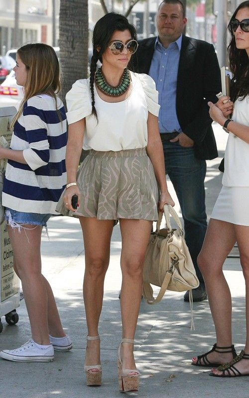 this look is adorable- love the short, pleaded skirt with the top. the necklace and wedge strapped heals make the outfit.