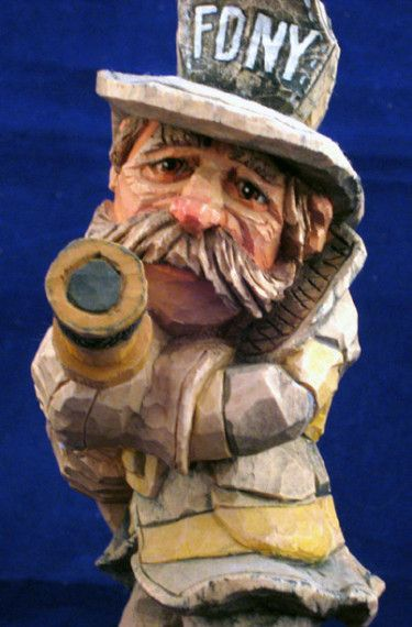 New york fire fighter carved by caricature carvers of