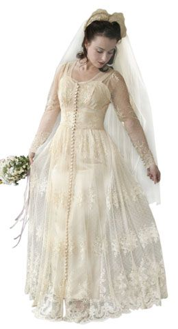 "reVamp's ""Lillian""  - Early 40s lace wedding dress featuring 58 buttons and loops at the center front of the gown."