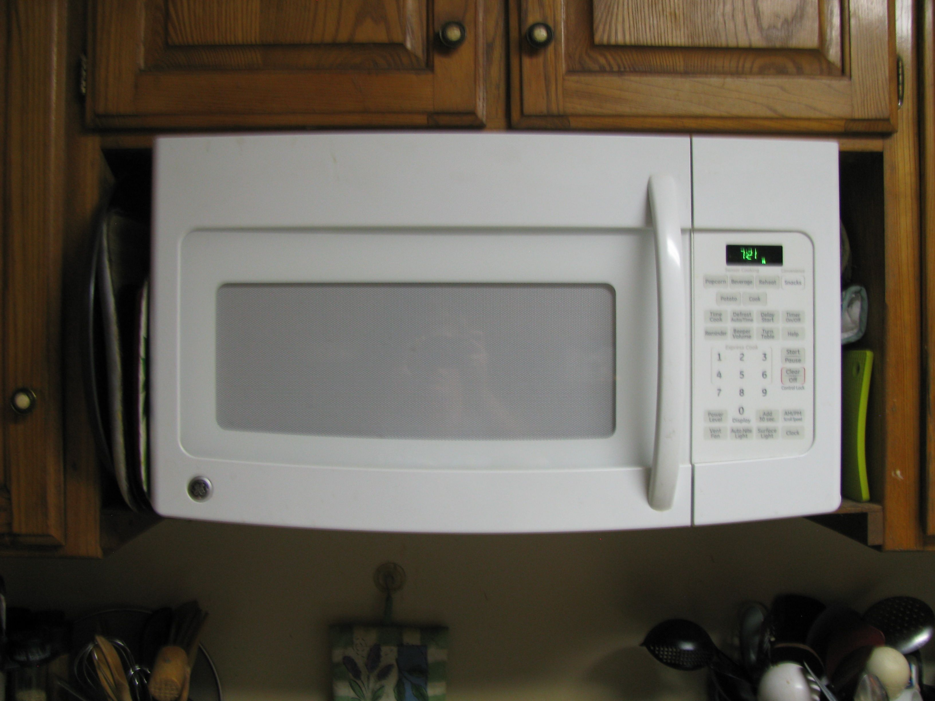 The Spaces On The Sides Of An Above Range Microwave Oven Hood Fan Light Are Frequently Just Dead Spaces Above Range Microwave Oven Hood Kitchen Range Hood
