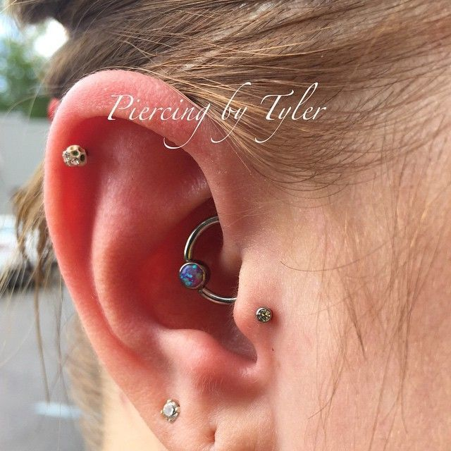 Fresh tragus  and daith piercing from today.                #piercing #daith #daithbowl2015 #michigan #metrodetroit #puremichigan #livonia #neocult #titanium #earpiercing #eternaltattoos #eternaltattooslivonia #appmember #safepiercing #swass