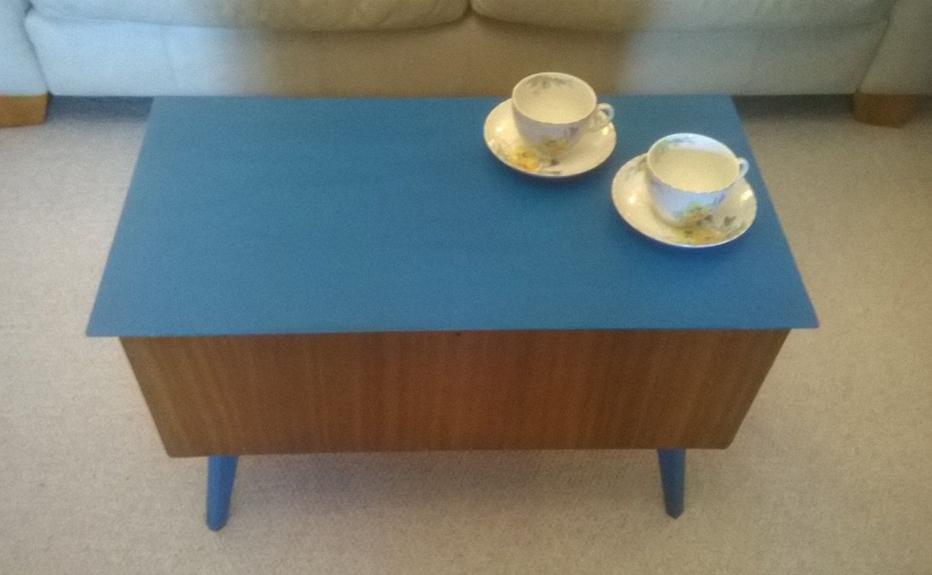 Mid century partially hand painted in teal teak coffee table