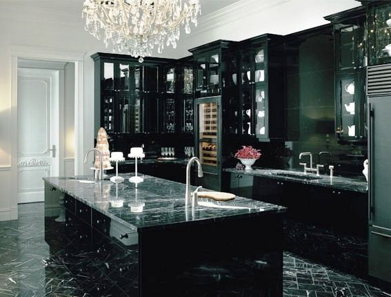 Black-kitchen-with-marble-countertop-sink-and-cabinets-with-marble ...