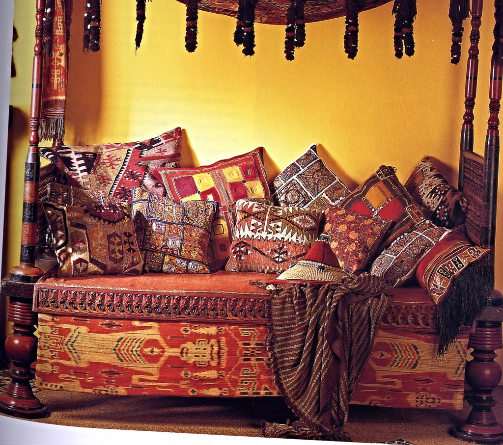 An exotic day bed furnished with cushions formed from scraps of