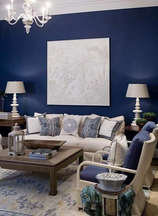 Blue accent wall with cream fabric and dark wood for for Living room 4 pics 1 word