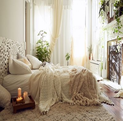 Luxury White Boho Style Bedroom Decorated With Plants And Thick Rugs On The Floor Plus Curtains Windows
