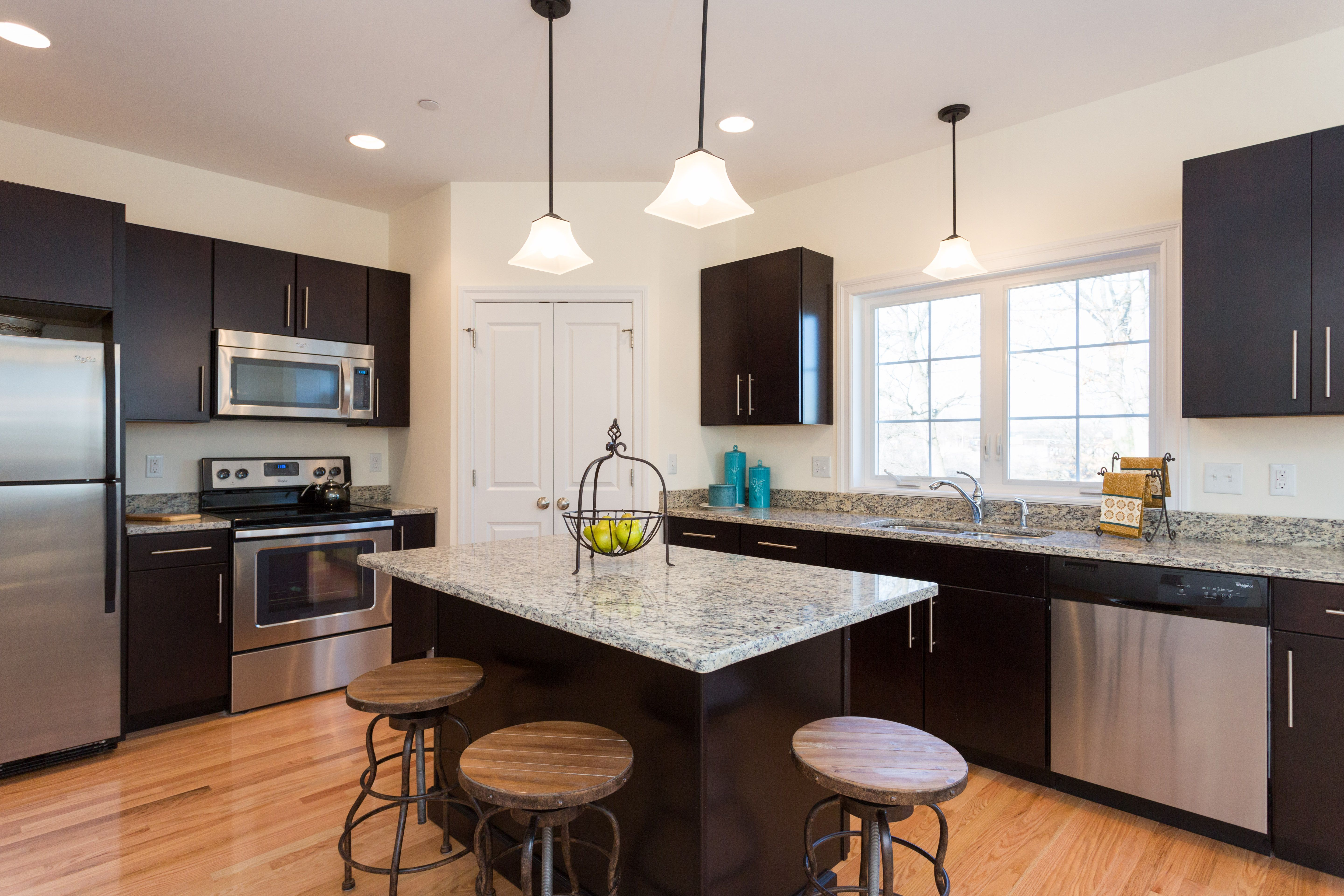 Clean Kitchen With Beautiful Contrast From The Countertops And Cabinets In Riverwalk Place Located In Manchester New Home Communities Clean Kitchen New Homes