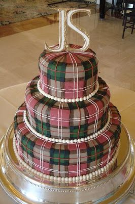 A tartan plaid pattern is softened by the pearls around the base of each tier of this one-of-a-kind wedding cake. Description from silverlandjewelry.com. I searched for this on bing.com/images