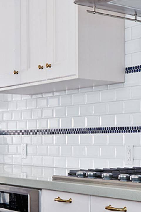 Subway tile with navy penny round stripes. Globe and Mail Real ...
