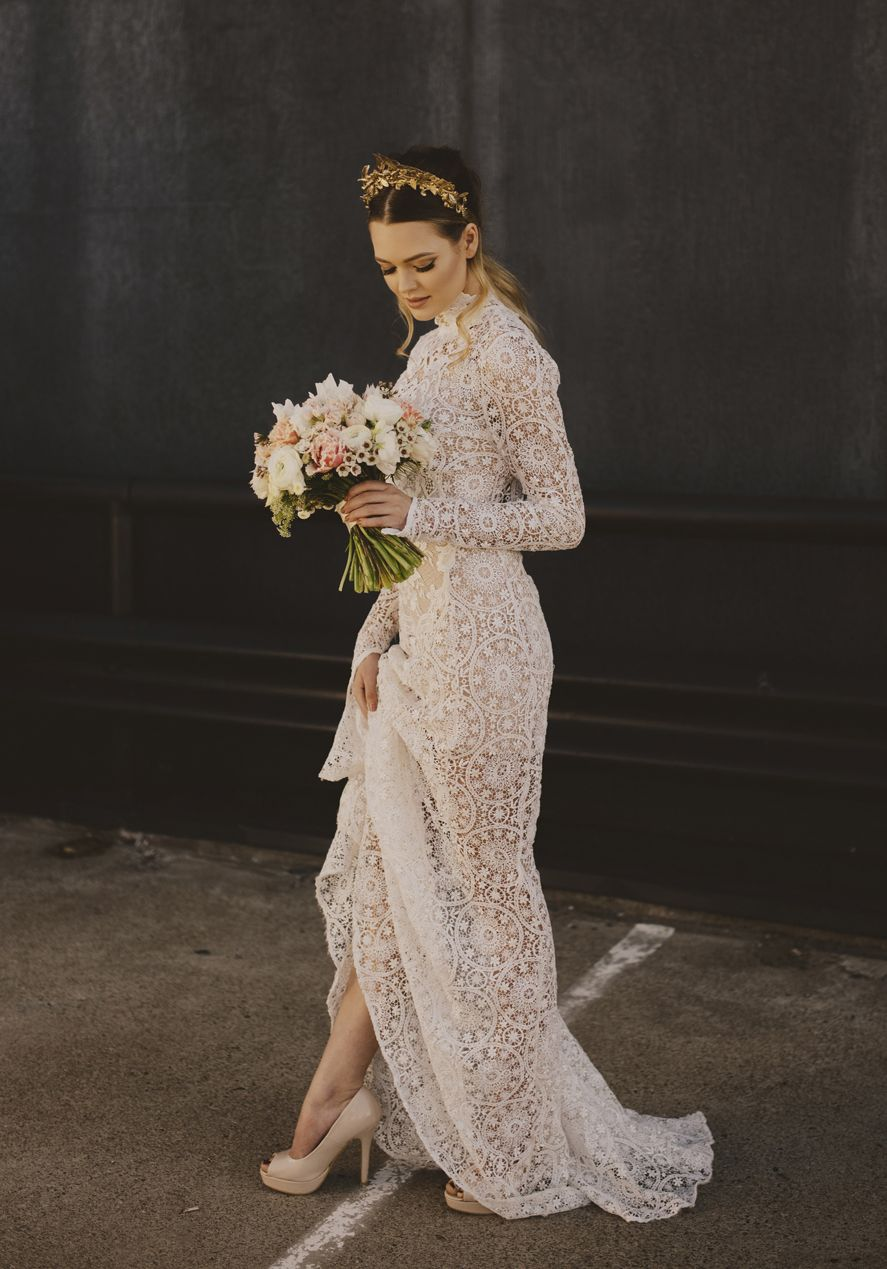 Long sleeve lace wedding dress with high neckline uhere comes the