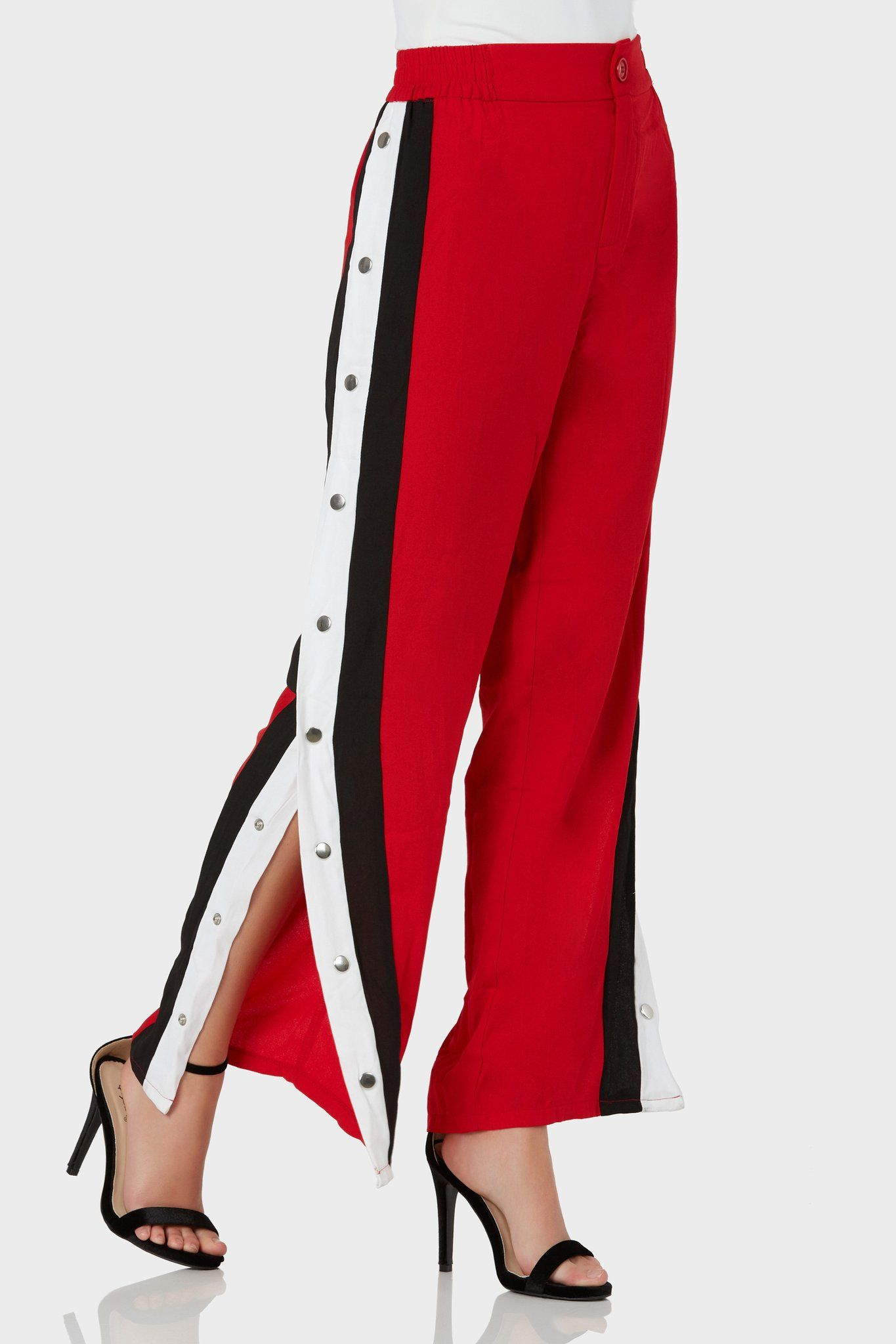 9a3115b3ed93 Trendy high rise pants with button zip closure. Contrast stripe detailing  with snap buttons down each side.