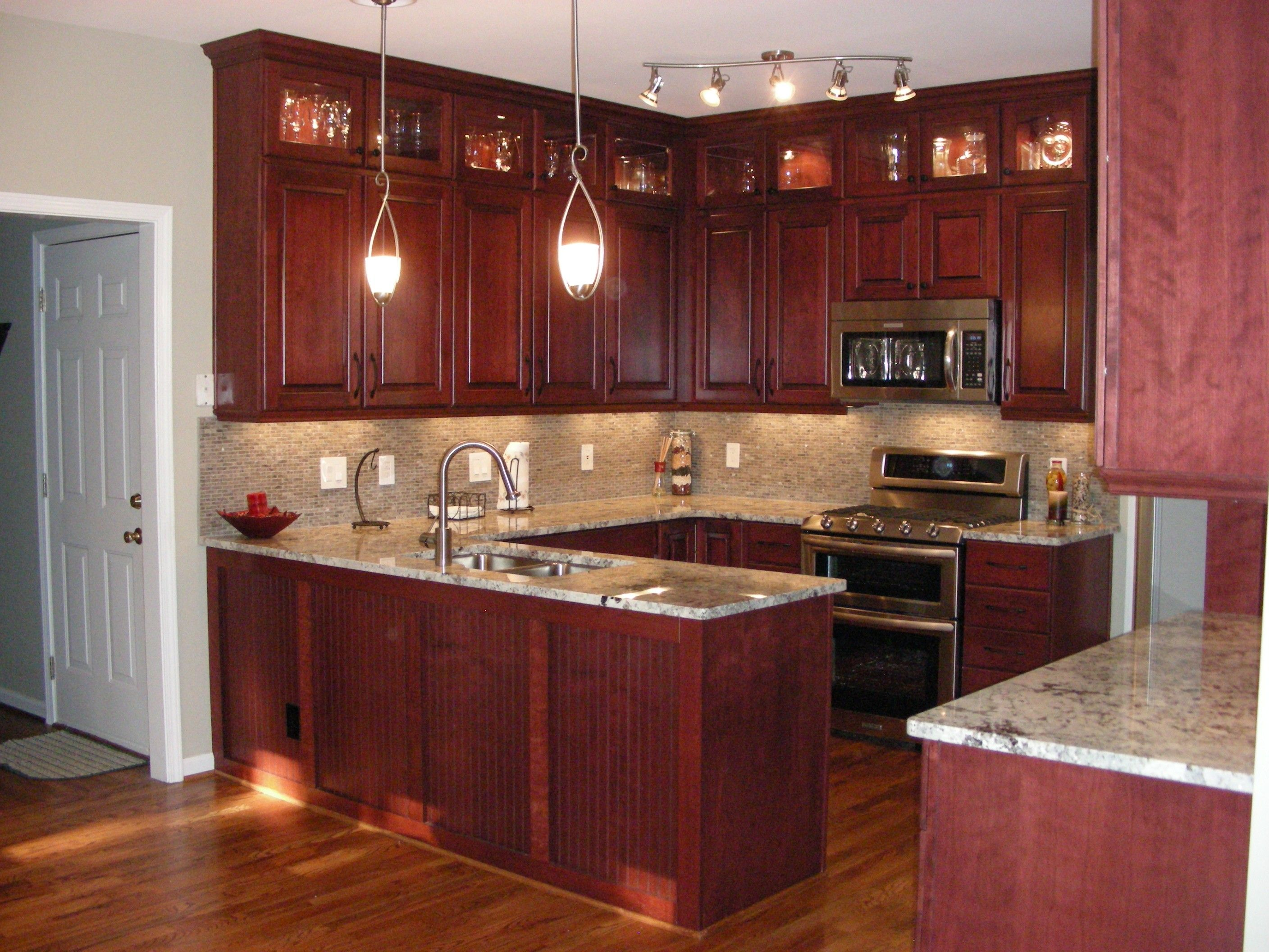 Cherry Kitchen Cabinets Black Granite like this, but bigger tiles in backsplash, and overall a little