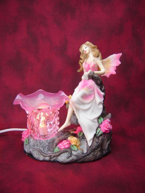 Electric Oil Wax Burner Warmer Diffuser. Great Gift Idea and Decor! http://mkt.com/pure-oils/m-pink-fairy #oils #waxtart #warmer #Wax #burner #homedecor #fairy #roses #lamp #Soywax #tart #giftideas