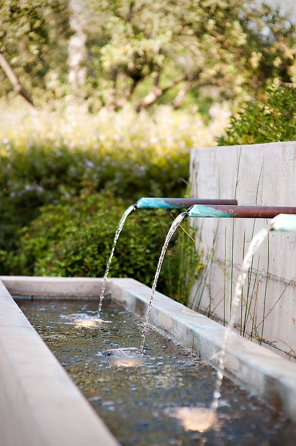 Simple Copper Spouts Direct Water Down Into An Illuminated Rectangular Trough Water Features In The Garden Modern Water Feature Outdoor Water Features