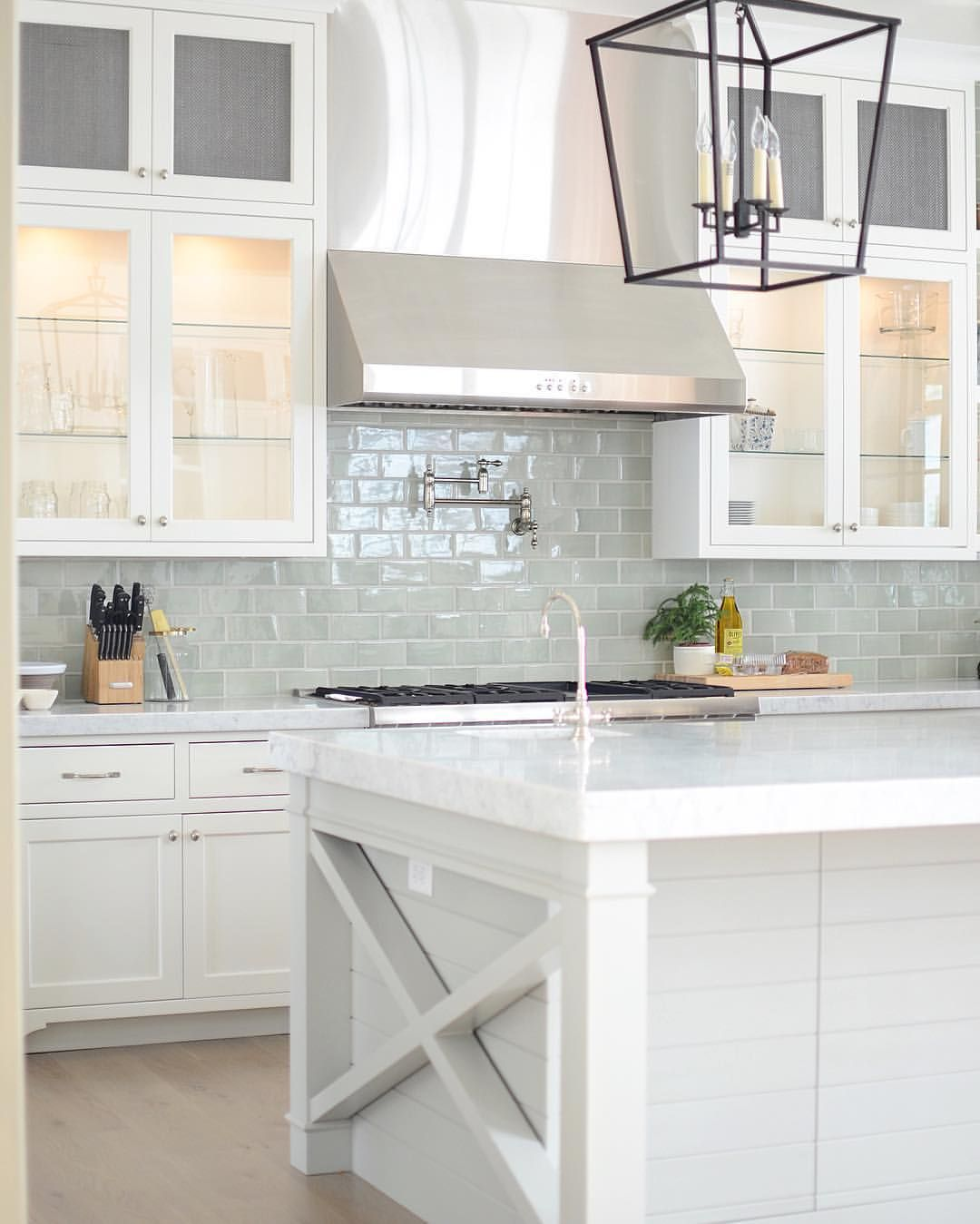 Bright white kitchen with pale blue subway tile backsplash White kitchen backsplash