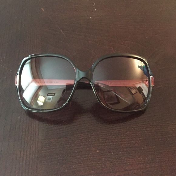 Marc by Marc Jacobs sunglasses Red/brown Marc by Marc Jacobs sunglasses. Good condition... Very small scratch in corner of lense- not noticeable. Marc by Marc Jacobs Accessories Sunglasses