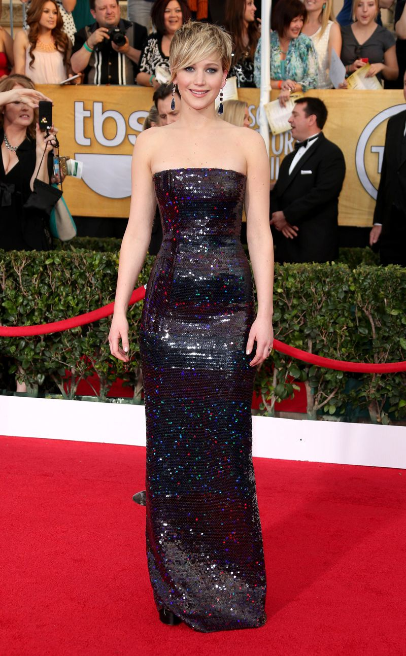 Jennifer Lawrence wears a sequined Christian Dior Couture column dress, Brian Atwood shoes, and Jennifer Meyer jewellery #SAGAwards