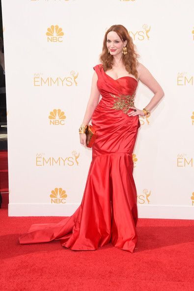 deb740cab64fd Emmys Best and Worst Dressed. The ultra curvy Christina Hendricks glided  down the carpet in a red one shoulder ruched gown by Marchesa