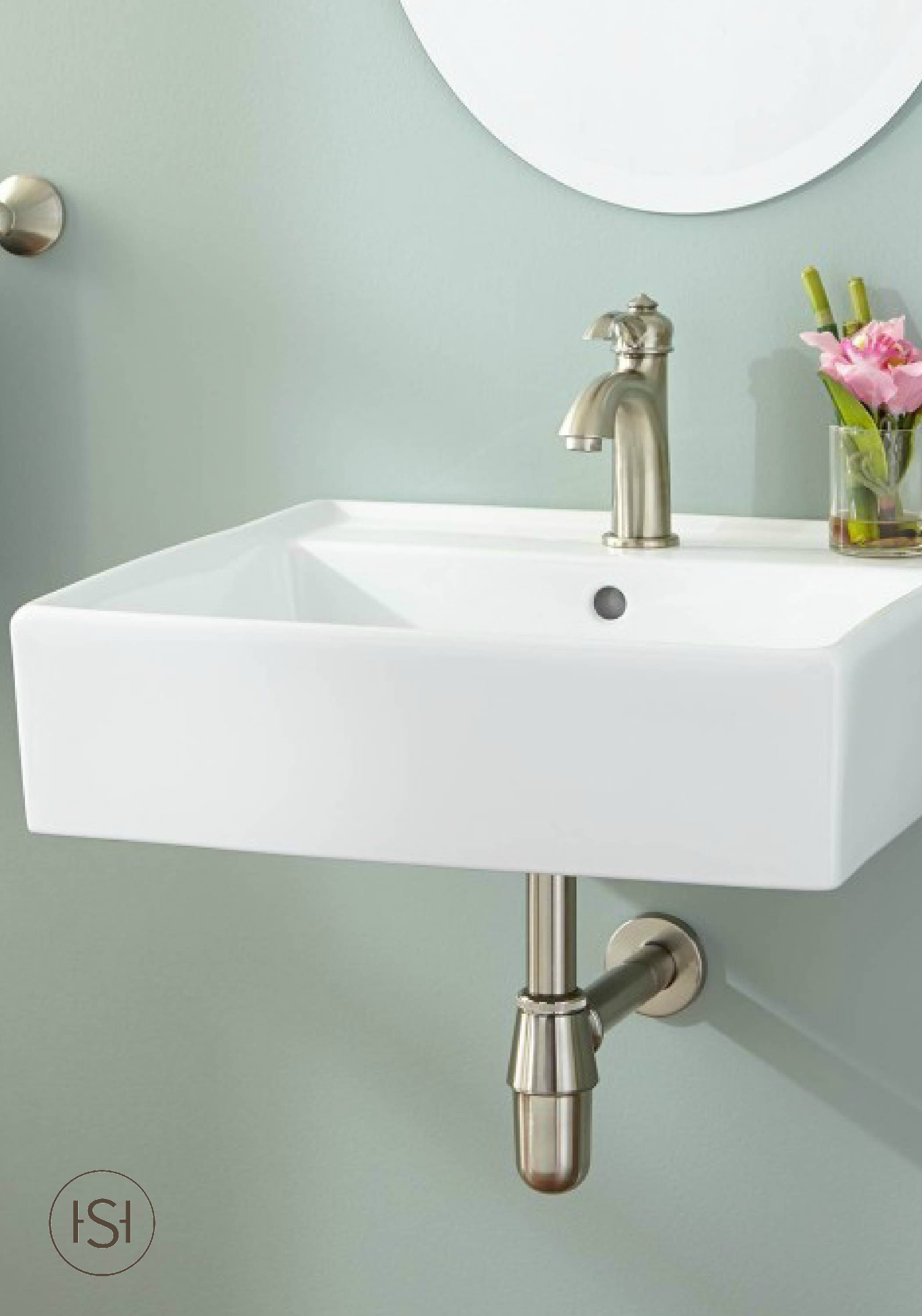 Small wall mounted bathroom sinks - Decorate Your Half Or Guest Bath With An Elegant Wall Mount Sink Featuring A