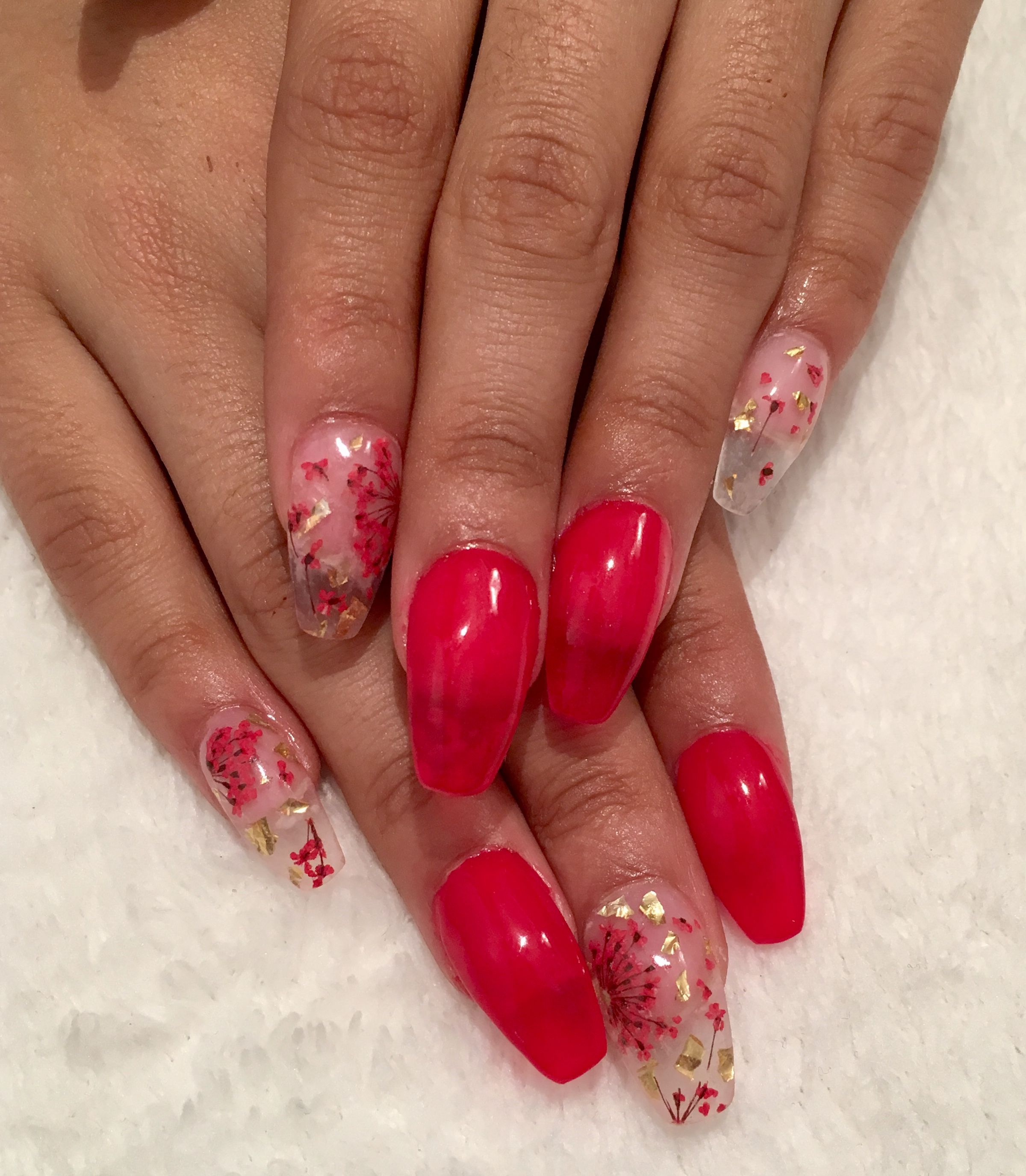 Red Nails With Clear Nail Accents With Gold Flakes And Red Flowers In Bedded In Nails Gold Nails Clear Nails Red Nails