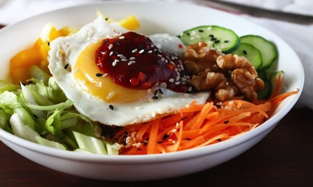 Amazing Korean salad bowl with raw veggies, egg, nuts and seeds, topped with spicy Gochujang paste – perfect for weekday lunch.