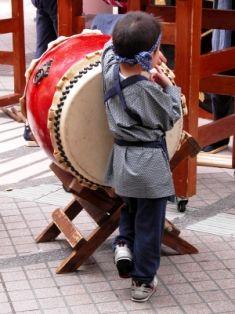 japanese-boy-playing-taiko-drum-at-festival.jpg