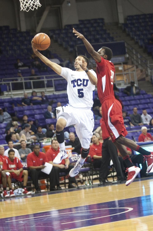 Kyan Anderson Goes For A Layup Against Lamar University Lamar University Sports Basketball Court