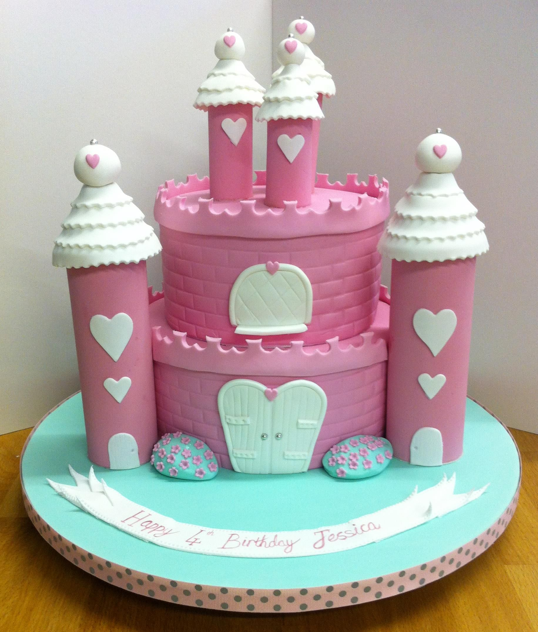 fun pink castle cake with a heart theme