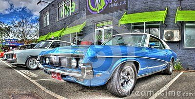 Vintage 1960s American blue and white 2 door Ford Mercury Cougar on display at car show in Melbourne, Australia.