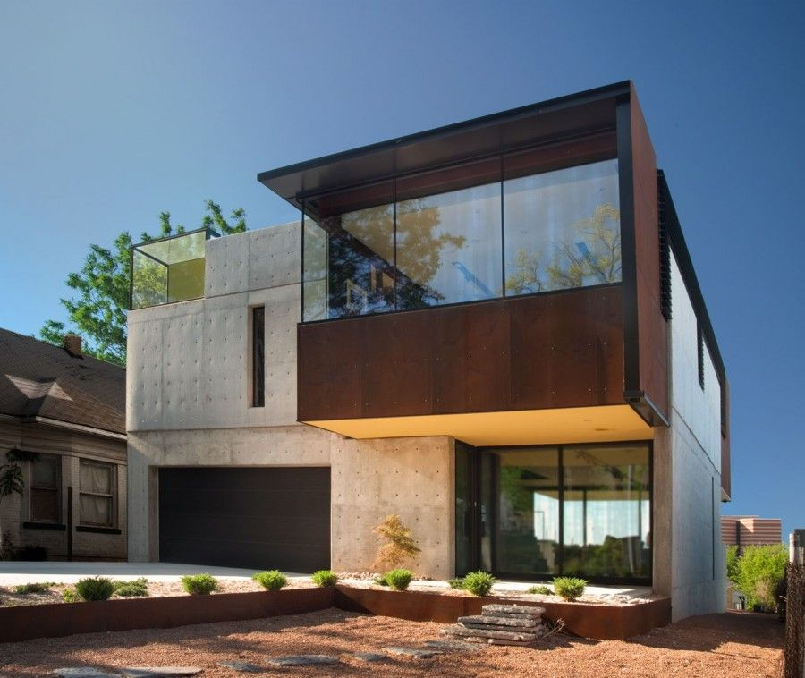 Wood concrete glass and steel house design at oklahoma for Elevated modern house design