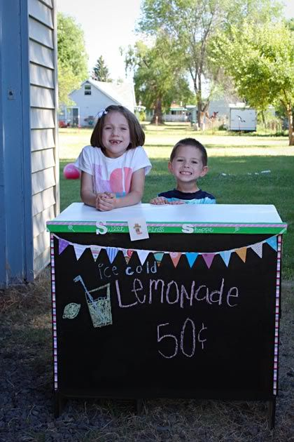 Good idea: paint the back of an old kid's desk with chalkboard paint so that it can double as a lemonade stand. When you're finished with it, put it back in the room and use as a desk again!