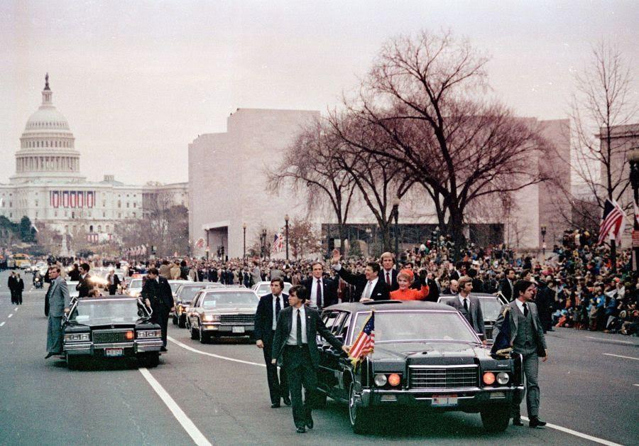 Secret Service agents protect President Reagan. United