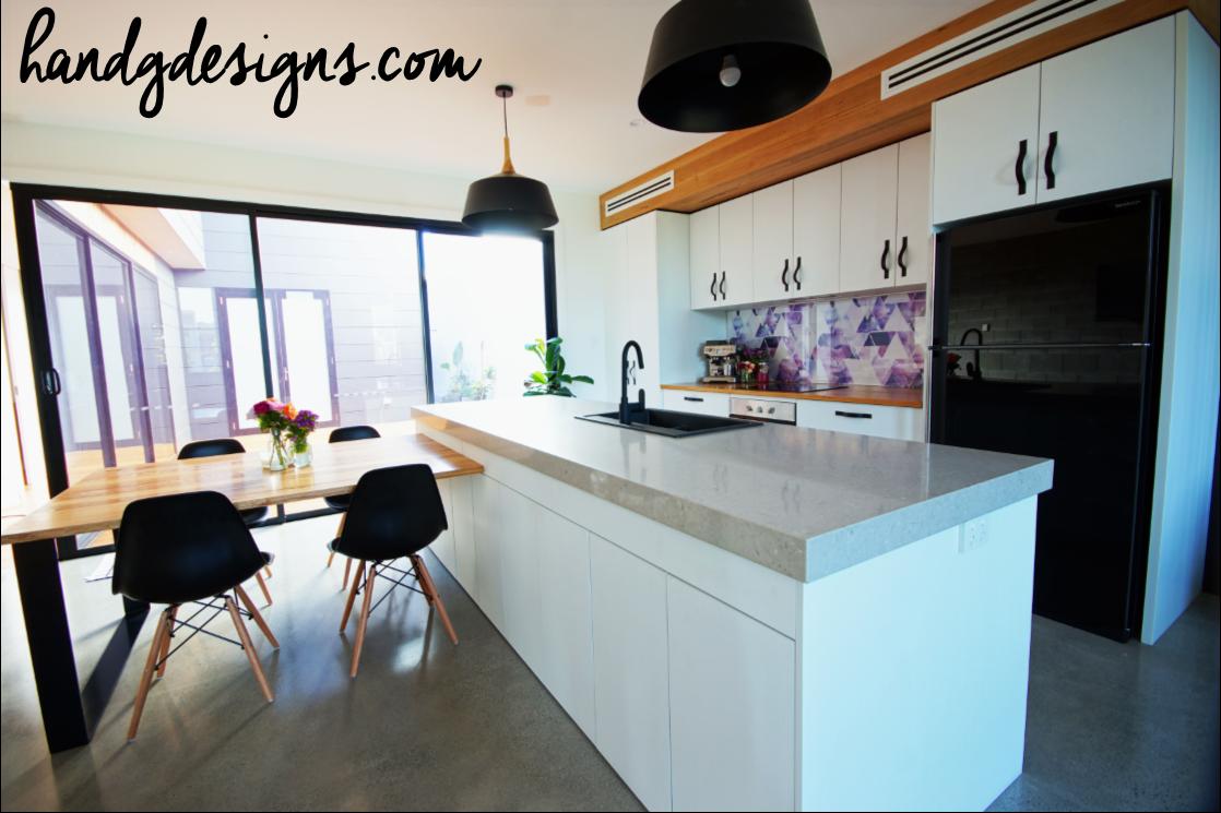Our Kitchen featuring a wallpaper splashback, blackbutt bulkhead ...