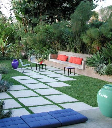 Love this idea to turn the driveway at the garage into a courtyard--pavers with strips of grass between them.