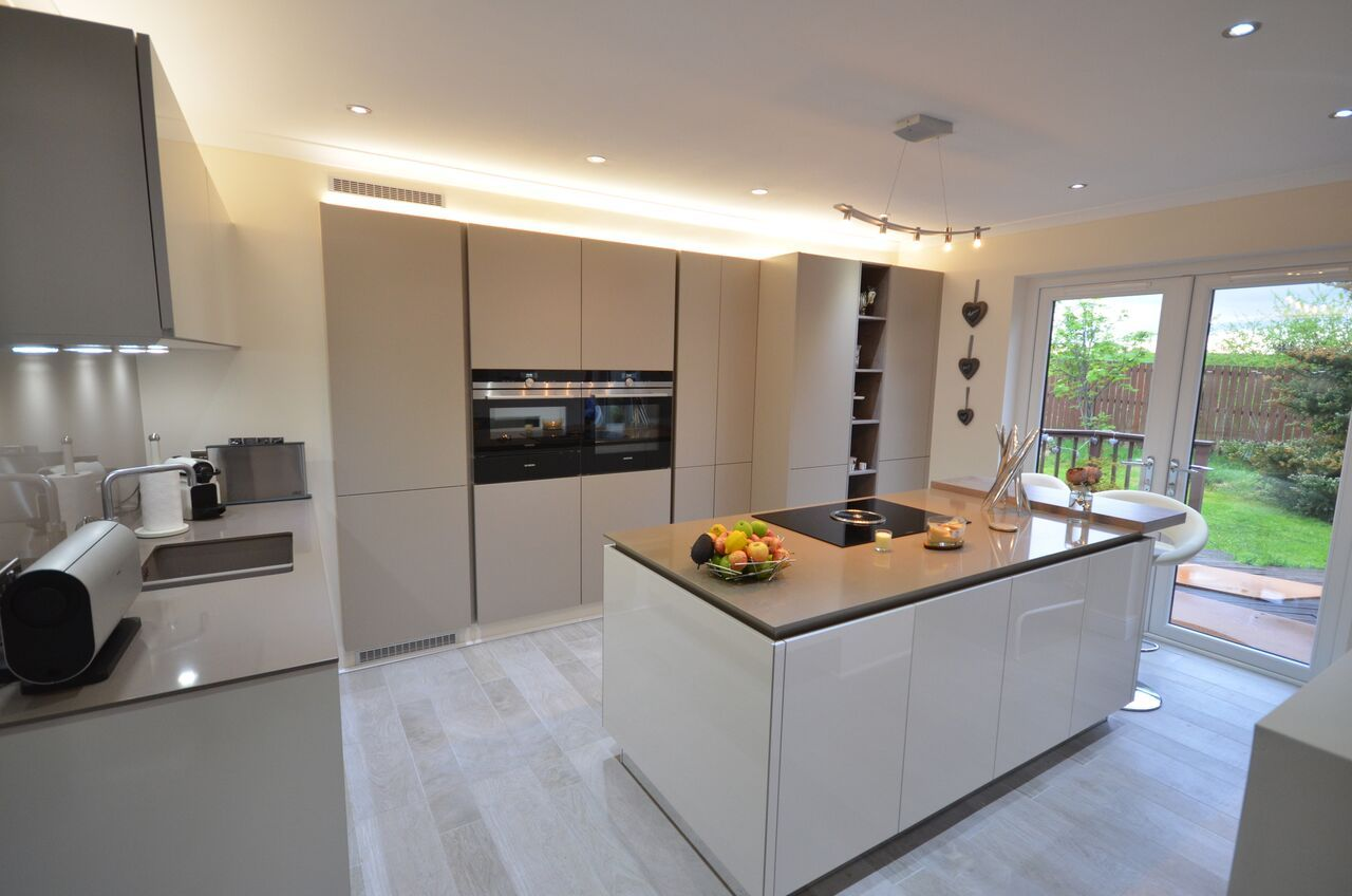 The tall bank of recessed kitchen units