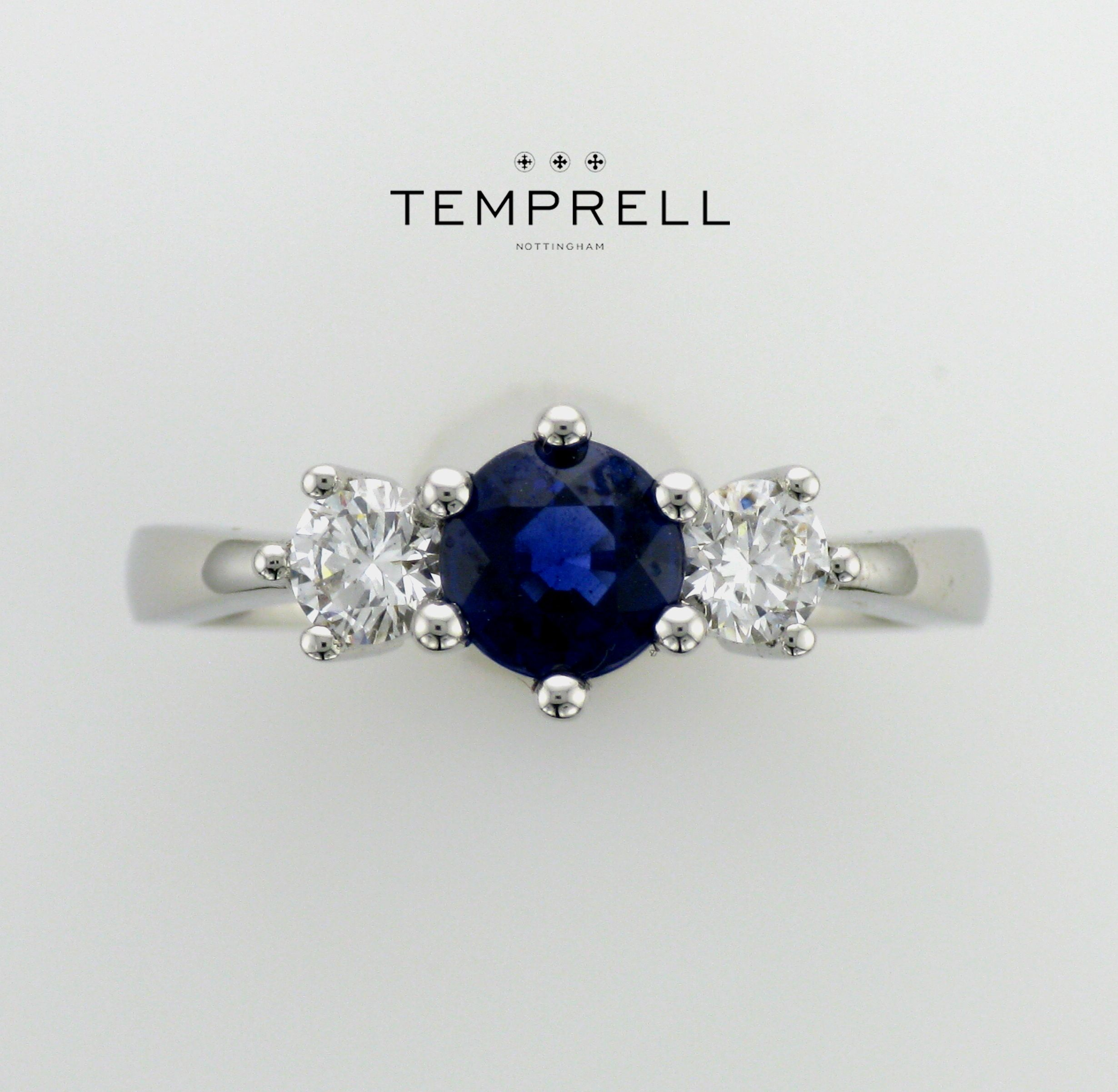 Rich royal round faceted blue sapphire trilogy ring. Hand pick your very own gemstone in store. www.temprellbespoke.com
