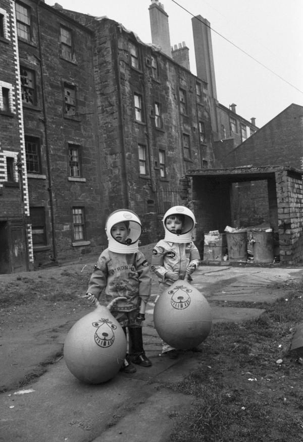 Boys with astronaut costumes and spacehoppers, Glasgow, 1970. Photograph by Gordon Rule.