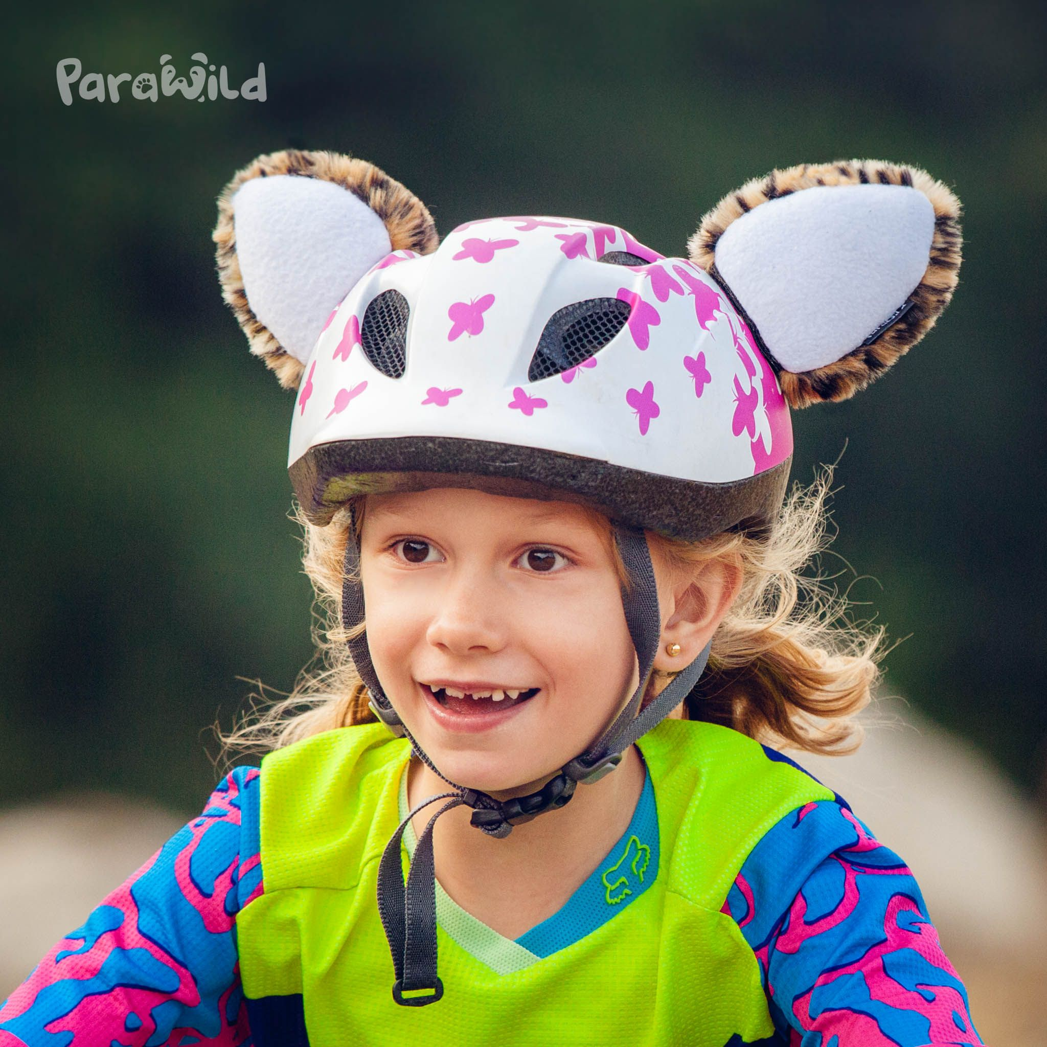 Cute plush leopard ears attach onto any helmet for active kids on