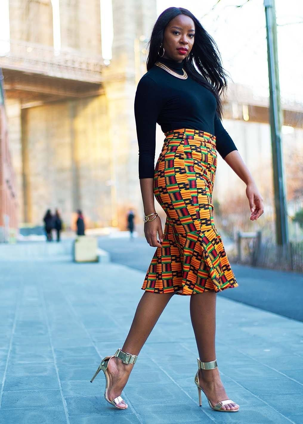 75038ea09a Style #3022BYK Our curve hugging gorgeous Tabia African print pencil skirt  with peplum hem is