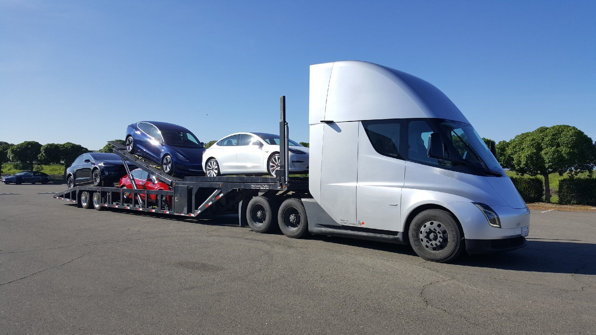 Tesla Semi Truck transporting Tesla cars in the latest