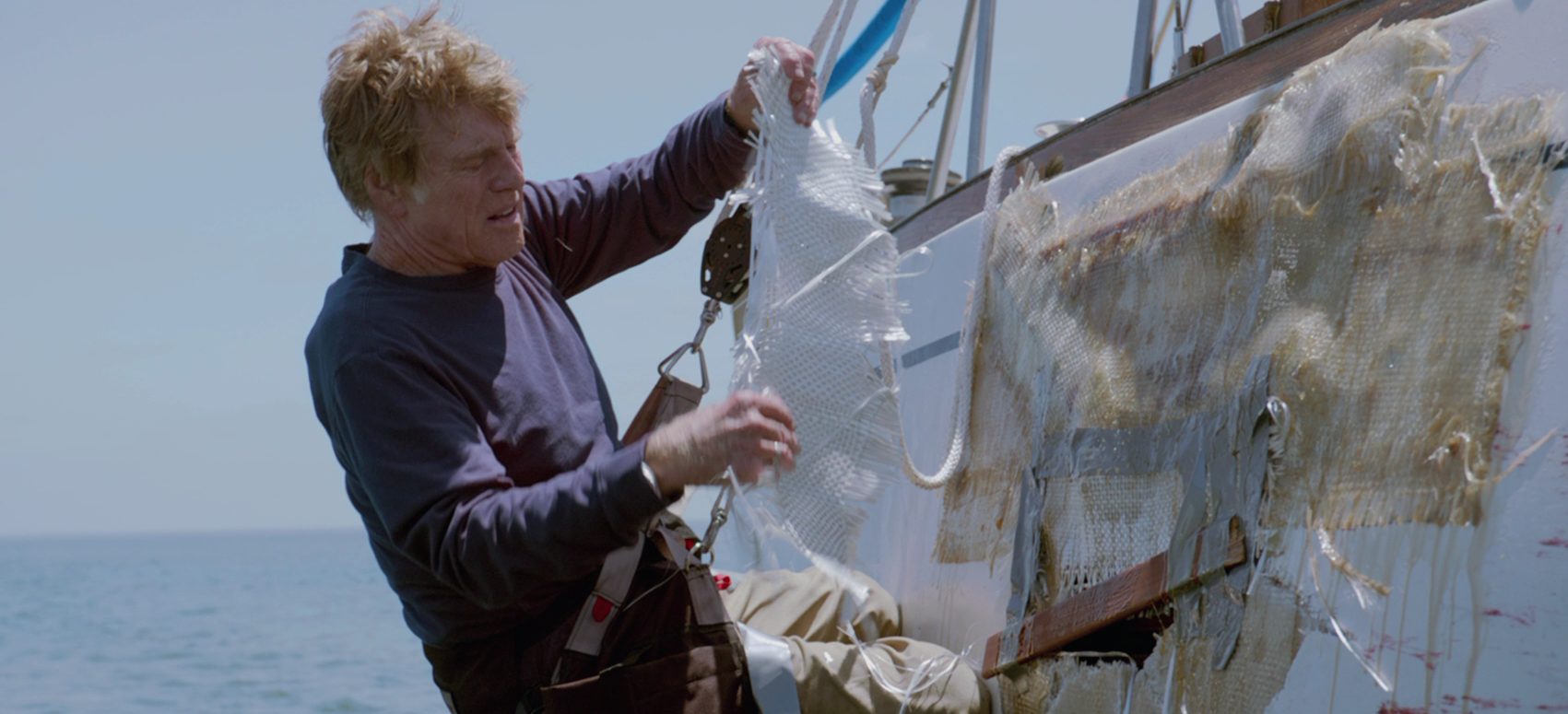 Robert Redford's nautical disaster movie stays silent and speaks volumes. Sailing solo in the Indian Ocean, a wedding ring and a couple maps are the only background information we have on Redford's character. All Is Lost is squarely focused on the present, as a storm sweeps in, bent on annihilating the tiny vessel. With pragmatic diligence, the film charts Redford's attempt to plug holes and mend broken parts. His life is in his own hands. So maybe flip through that old Boy Scout manual…