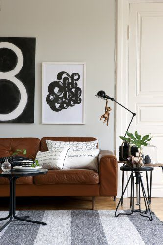 Love It. Tan Leather Sofa, Black And White Abstract Art, Nice Reading Table  Lamp. And A Monkey.