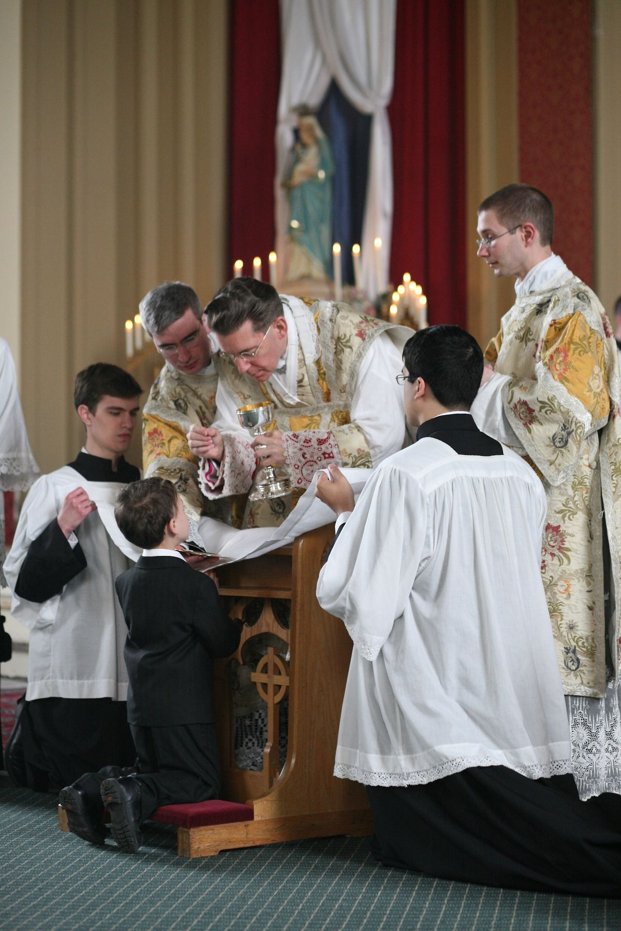 Communion with Christ.  Do you think our Catholics kids would understand that CHRIST IS PRESENT IN THE EUCHARIST if we taught them to receive Communion in a posture of REVERENCE?  Just wondering...