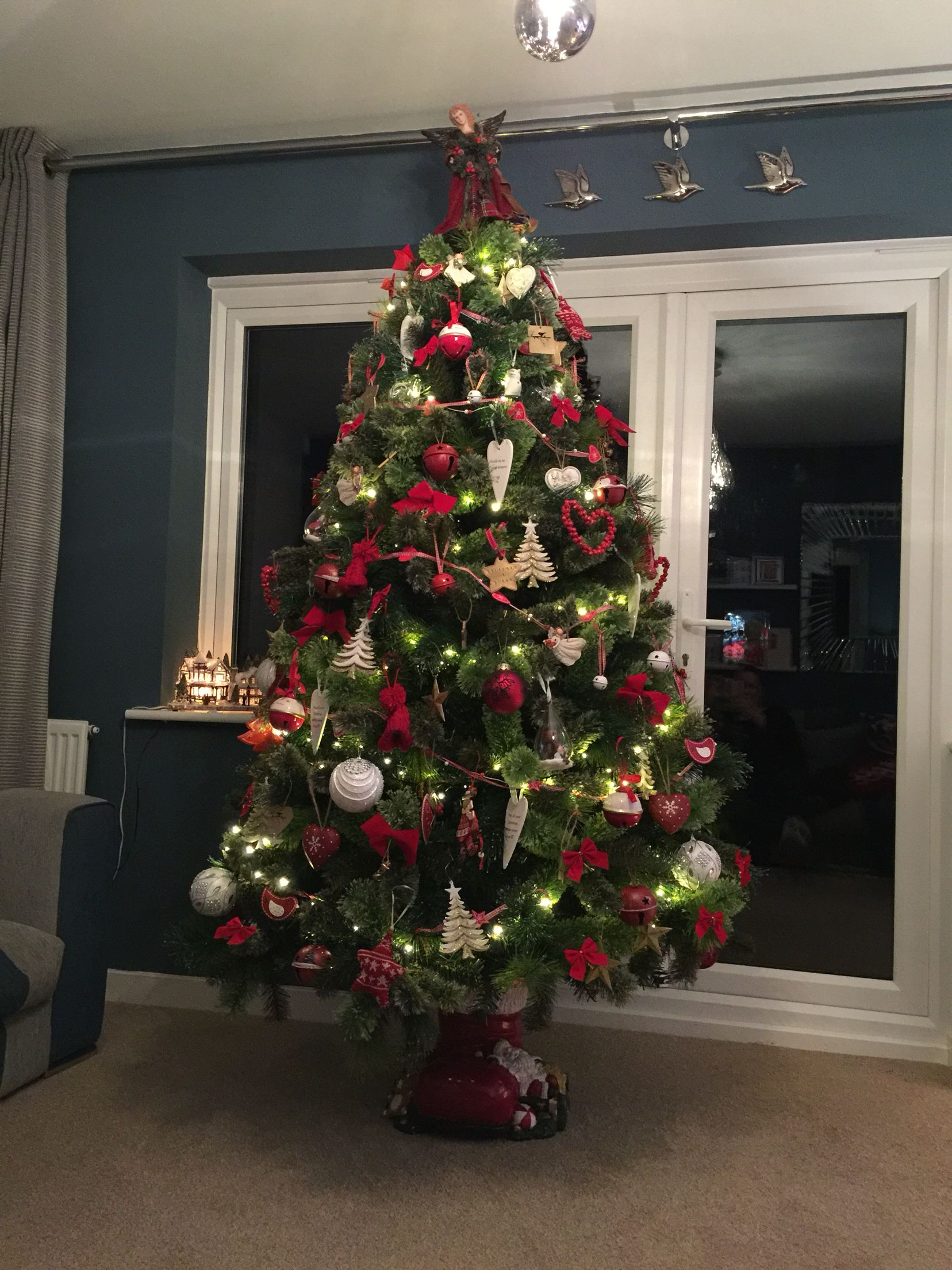 Christmas Tree Red White And Gold Decorations Sitting In A