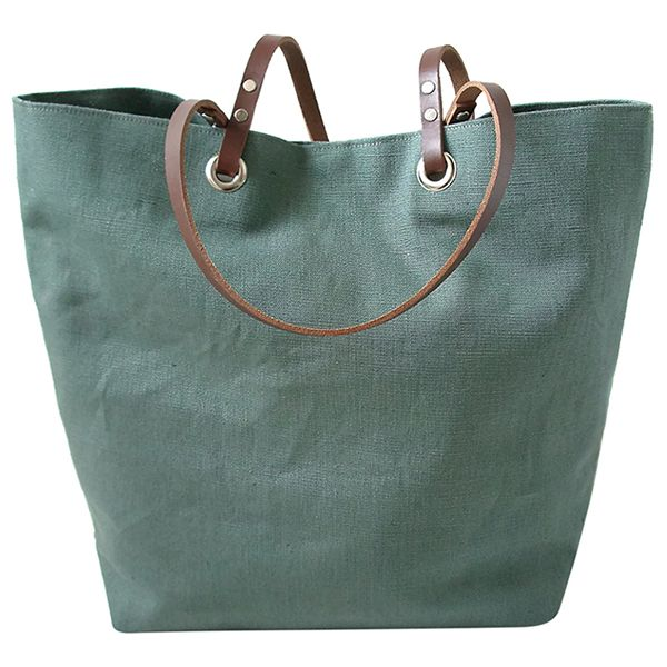 Linen + leather = the beach bag of our dreams.