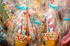 party favors: real ice cream cones, tops were dipped in white candy coating and then rolled in jimmies.  Filled with sour ropes, stickers, pixi stix, gum balls and party blowers.
